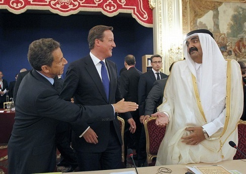 France`s president Nicolas Sarkozy and British Prime Minister with the emir of Qatar, Sheikh Hamad bin Khalifa al-Thani