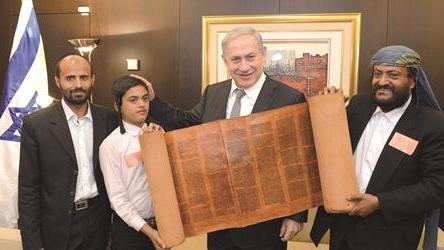 Benjamin Netanyahu poses with an 800-year-old Sefer Torah - and the Yemeni Jews who smuggled it to Israel